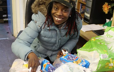 Food bank client with food parcel